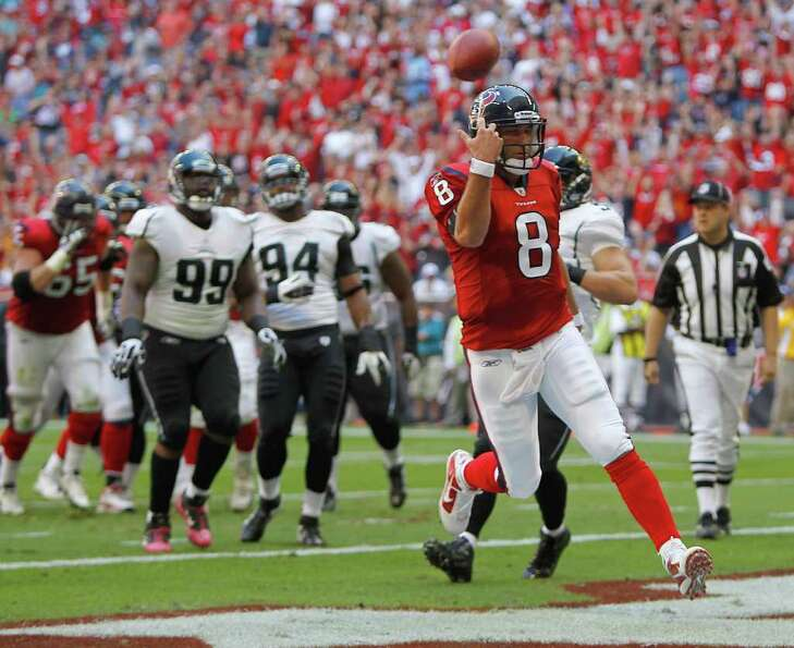 Houston Texans quarterback Matt Schaub (8) runs in for the first touchdown of the game.