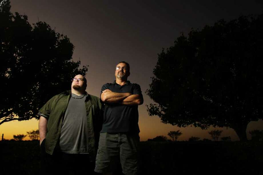 James Sangster, left, a paranormal investigator with Houston Ghost Research, stands with Tony Barton, who also is an investigator and the group's medium. A couple who say their house is haunted sought help from Houston Ghost Research. Photo: Nick De La Torre / © 2011  Houston Chronicle