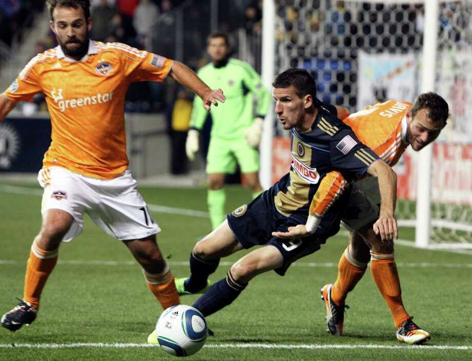 Philadelphia Union's Sebastien Le Toux gets in the middle of Houston Dynamo's Adam Moffit, left, and Brad Davis during the 2nd half of MLS Cup Eastern Conference Semifinals at PPL Park in Chester Pennsylvania, Sunday, October 30, 2011. (Steven M. Falk/Philadelphia Daily News/MCT) Photo: Steven M. Falk / Philadelphia Daily News