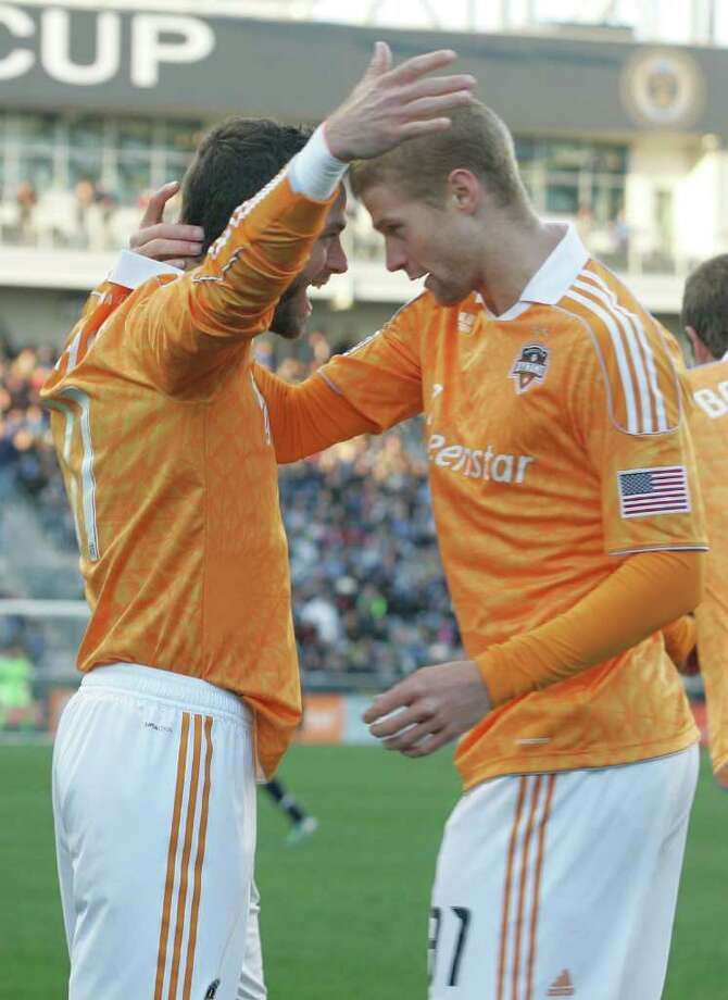 CHESTER, PA - OCTOBER 30:  Brad Davis #11 of the Houston Dynamo celebrates a goal with Andre Hainault #31 during an MLS soccer playoff game against the Philadelphia Union, October 30, 2011 at PPL Stadium in Chester, Pennsylvania.  (Photo by Chris Gardner/Getty Images) Photo: Chris Gardner / 2011 Getty Images