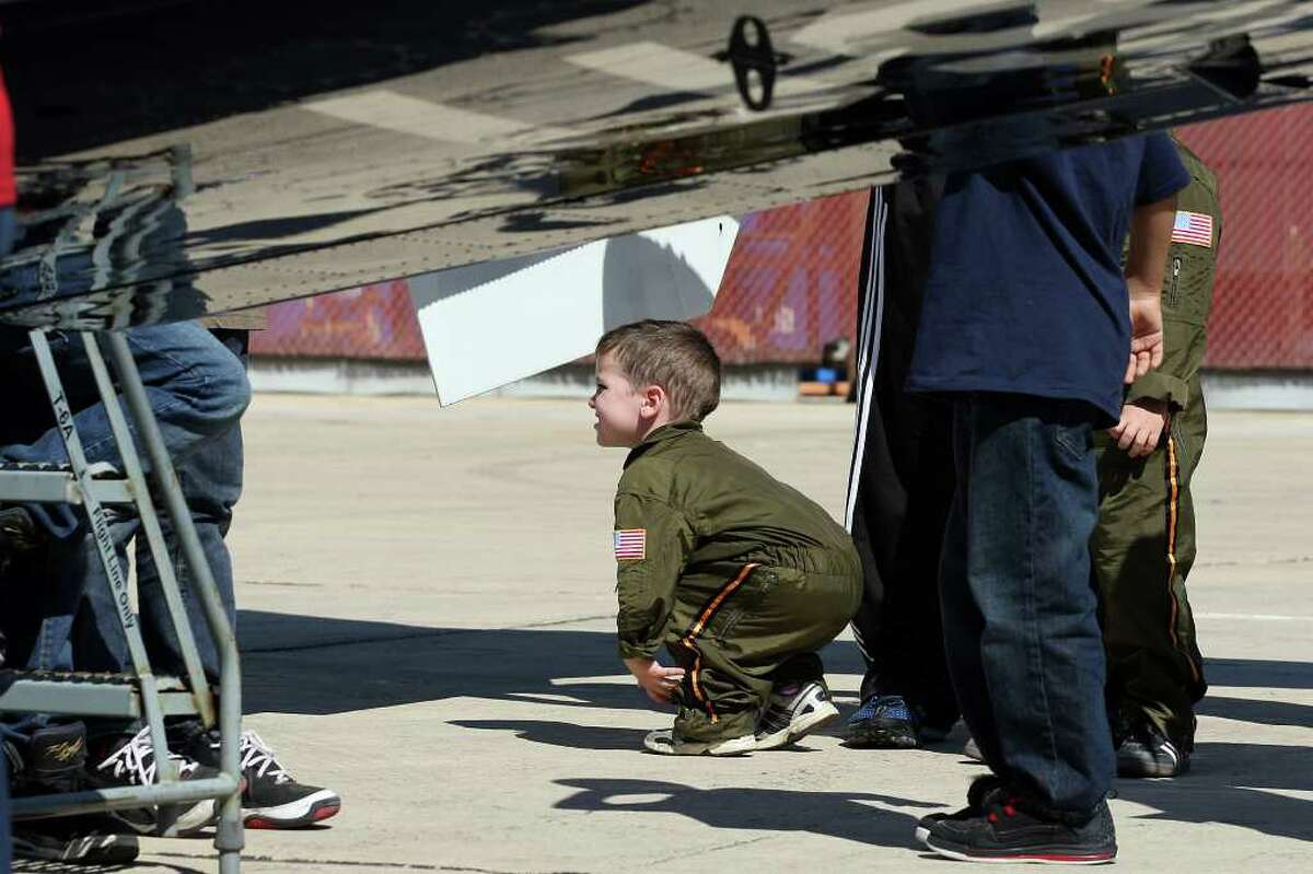 Jay Campbell, 2, checks out the under belly of a T-6A Texan II during the last day of the Randolph Air Show, Sunday, Oct. 30, 2011. The show featured the U.S. Navy Blue Angels as its finale. The Texan is part of the 359th Flying Training Squadron at the base. Campbell was dress in his Halloween costume.