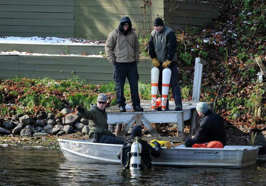 A diver gets instruction regarding  the search for a missing man in Galway Lake in Galway, N.Y. October 31, 2011.    (Skip Dickstein / Times Union) Photo: SKIP DICKSTEIN / 2011