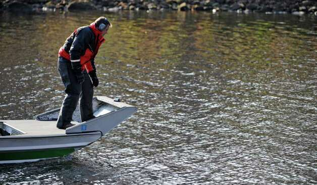 A state Forest Ranger conducts a search for a missing man in Galway Lake in Galway, N.Y. October 31, 2011.    (Skip Dickstein / Times Union) Photo: SKIP DICKSTEIN / 2011