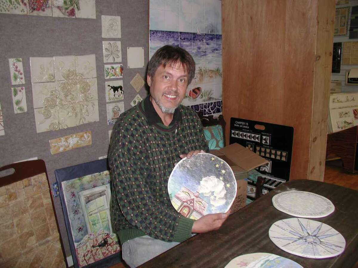 Norwalker Kim Salander, co-owner of Wirth-Salander Studio in Wilton, with pre-finished plates that will be glazed, fired and formed into cake plates at his studio.
