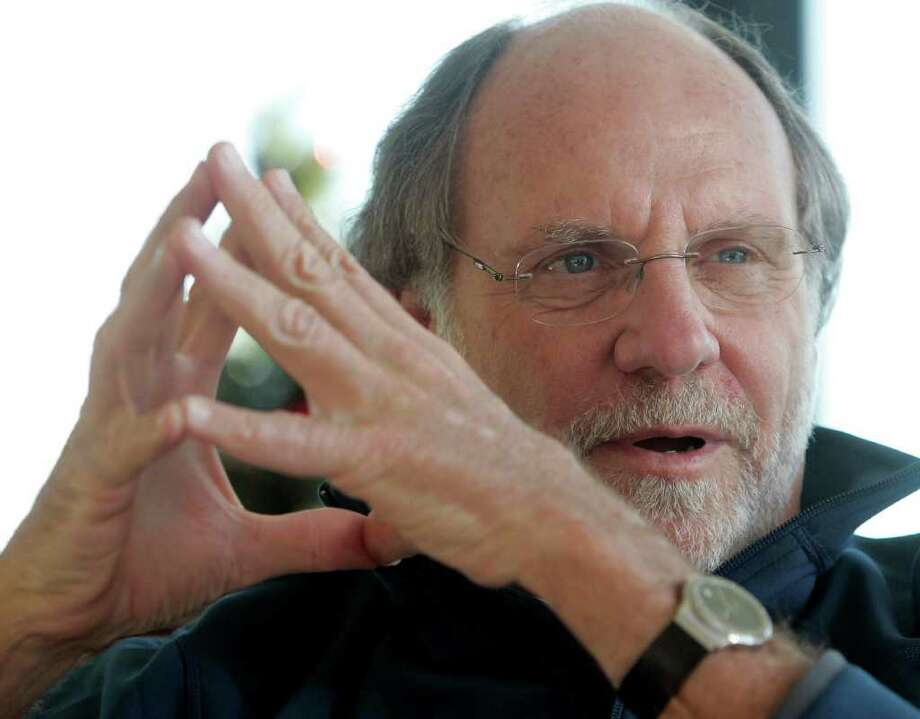 FILE - In this Jan. 9, 2011 file photo, former New Jersey Gov. Jon S. Corzine reflects on his four year term in office during an interview with The Associated Press at his home in Hoboken, N.J. MF Global Holdings Ltd. has been suspended from conducting new business with the New York Fed amid reports that the company plans to file for bankruptcy. (AP Photo/Rich Schultz, File) Photo: Rich Schultz / AP2010