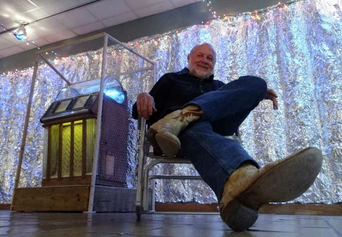 """Artist Bob Wade sits by his exhibit, """"Wired for Sound,"""" which includes a jukebox, at the Schuech Fine Arts Center at Texas Lutheran University on Oct. 27, 2011. BILLY CALZADA / gcalzada@express-news.net roy bragg story"""