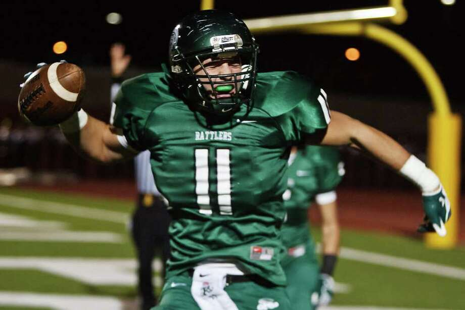 Connor Knight and the Reagan Rattlers can complete their unbeaten run through District 26-5A with a victory against Roosevelt on Saturday. Photo: Marvin Pfeiffer/Express-News / Express-News 2011