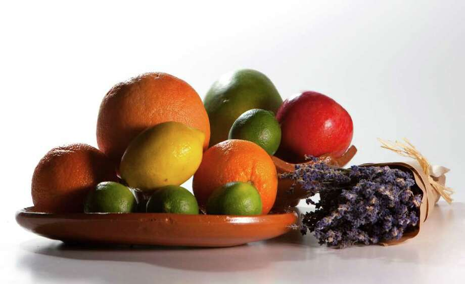 Mango's, lavender, limes, oranges, apples and lemons, photographed in the Chronicle studio Friday, Oct. 14, 2011, in Houston. In marketing to Hispanic consumers scent is an important element in food and cleaning products, according to Procter Gamble and Kraft, whose research has shown that the following smells test well with Hispanic consumers -- particularly Latinas -- whose growing numbers in the U.S. make them a group with increasing spending power.   ( Johnny Hanson / Houston Chronicle ) Photo: Johnny Hanson, Staff / © 2011 Houston Chronicle