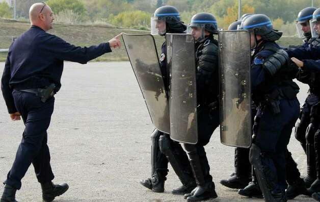 French police officers are seen during a training session in Nice ahead of the G20 summit of Cannes, southeastern France, Monday, Oct. 31, 2011. G20 leaders will gather in Cannes for the final summit of France's presidency Nov. 3 and 4, 2011 Photo: Michel Spingler, AP / AP