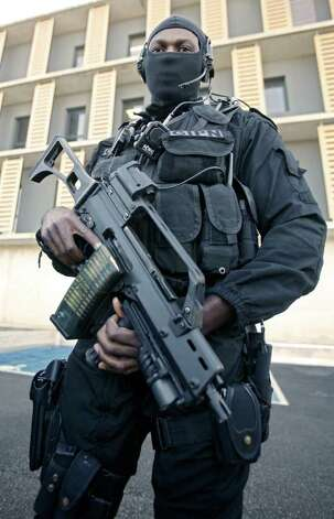 A policeman of GIPN (French National Police Intervention Groups) is seen during a training session in Nice, southern France, Wednesday, Oct. 26, 2011, ahead of the G20 leaders summit on November 3-4 in Cannes, near Nice . Photo: Lionel Cironneau, AP / AP