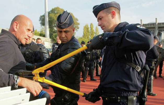 French police officers during a training session in Nice ahead of the G20 summit of Cannes, southeastern France, Monday, Oct. 31, 2011. G20 leaders will gather in Cannes for the final summit of France's presidency Nov. 3 and 4, 2011 Photo: Michel Spingler, AP / AP