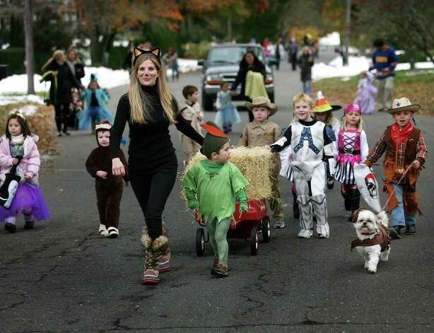Erica Wuchiski leads a Halloween parade of neighborhood children up Deerfield Drive in Trumbull on Monday, October 31, 2011. Photo: Brian A. Pounds / Connecticut Post