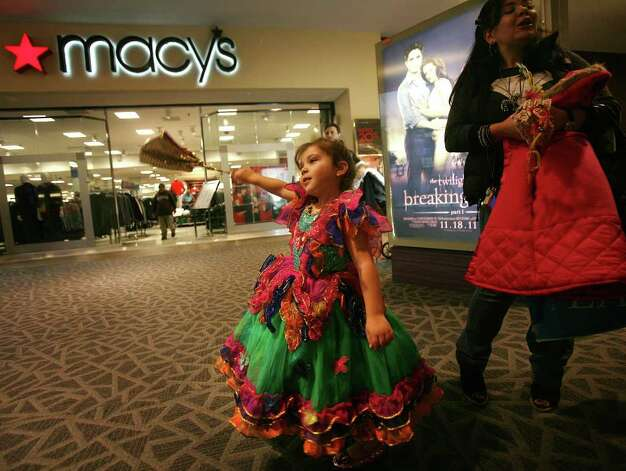 "Dressed as ""the Butterfly Queen"", Arianna Arias, 4 of Bridgeport, prepares to trick or treat for Halloween with her mother Monica Arias at the Westfield Trumbull Mall on Monday, October 31, 2011. Photo: Brian A. Pounds / Connecticut Post"