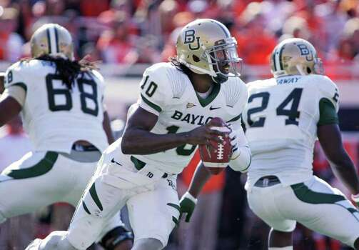 STILLWATER, OK - OCTOBER 29:  Quarterback Robert Griffin III #10 of the Baylor Bears looks to throw in the first half against the Oklahoma State Cowboys on October 29, 2011 at Boone Pickens Stadium in Stillwater, Oklahoma.  Oklahoma State defeated Baylor 59-24.  (Photo by Brett Deering/Getty Images) Photo: Brett Deering / 2011 Getty Images