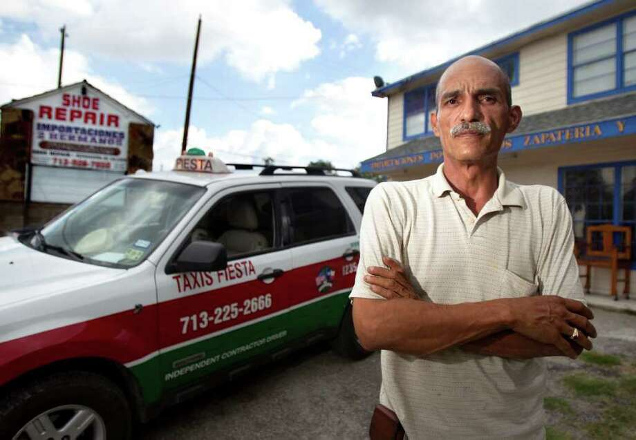 CODY DUTY : CHRONICLE TO PAY BILLS: Victor Gomez Sr., says the 60 percent loss of business at his shoe shop due to light-rail construction has forced him to drive a cab to make up for the loss of income. Photo: Cody Duty / © 2011 Houston Chronicle