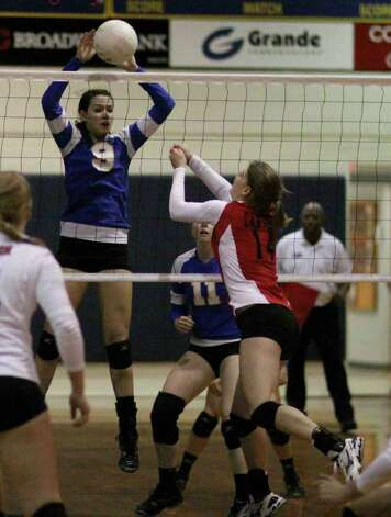 Alamo Heights' Jemma Miller — seen here responding to New Braunfels Canyon with a kill — recorded a school-record seven blocks as the Mules topped Smithson Valley for the No. 2 seed out of District 27-4A. Photo: Mary Candee/Special To The Express-News