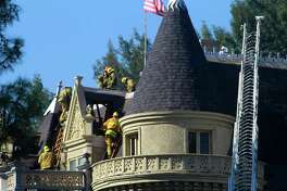 Los Angeles City firefighters mop up after an attic fire damaged the Magic Castle in Hollywood, Calif., Monday afternoon Oct. 31 2011. The spooky headquarters for generations of stage magicians, the Magic Castle, was closed by the fire and shut down its Halloween activities, including a seance. (AP Photo/Los Angeles Times, Brian van der Brug) MANDATORY CREDIT: Brian van der Brug/Los Angeles Times/Los Angeles Times; NO FORNS; NO SALES; MAGS OUT; ORANGE COUNTY REGISTER OUT; LOS ANGELES DAILY NEWS OUT; VENTURA COUNTY STAR OUT; INLAND VALLEY DAILY BULLETIN OUT; SAN BERNARDINO SUN OUT; TV OUT; INTERNET OUT