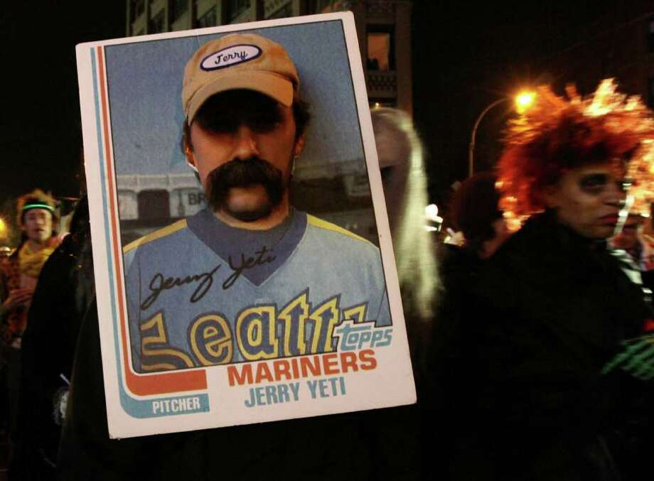 Halloween in Seattle was a chilly but dry affair. And overall, it was pretty quiet. In New York, however, the annual Halloween parade was in full swing. Dressed as a baseball card of a Seattle Mariners who never existed, Jerry Aman was one of the hundreds of revelers to take Manhattan on Monday. Photo: AP