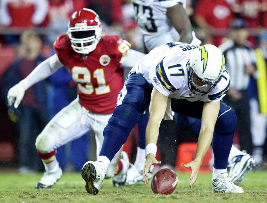 Oct. 31: Chiefs 23, Chargers 20 OT. San Diego Chargers quarterback Philip Rivers (17) chases after his fumble before being tackled for a loss with 14:10 remaining in overtime. The Kansas City Chiefs defeated the San Diego Chargers, 23-20, during Monday's football game on October 31, 2011, in Kansas City, Missouri. (John Sleezer/Kansas City Star/MCT) Photo: John Sleezer, McClatchy-Tribune News Service / Kansas City Star