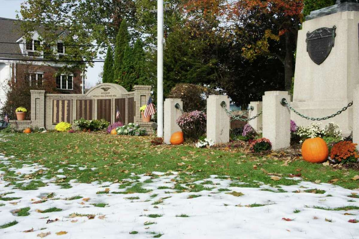 Pockets of snow cover a Halloween-themed Veterans Green on Oct. 31, 2011. The NWS said there is a chance of
