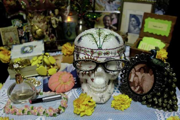 An altar honoring Esther Alaniz on exhibit during the annual festival Dia De Los Muertos at  MECA, 1900 Kane,  Saturday, Oct. 29, 2011, in Houston.  Dia de los Muertos or Day of the Dead is a traditional Latin American holiday that honors and celebrates the lives of family and friends who died. Traditionally held November 1 and 2,  the belief is that the dead return home, visit loved ones, and feast on their favorite foods.  The festival continues Sunday, October, 30 from 11 am to 6 pm.  The event features an altar exhibit,  foods, arts and crafts, music and dance performances, and a children's area with art and game activities. Photo: Melissa Phillip, Houston Chronicle / © 2011 Houston Chronicle