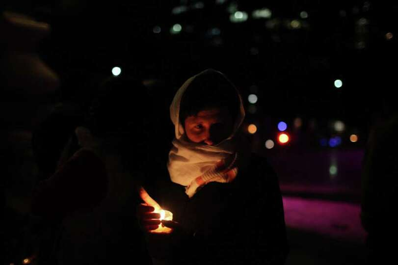 A woman holds a candle during a protest against violence during Day of the Dead celebrations in Mexi