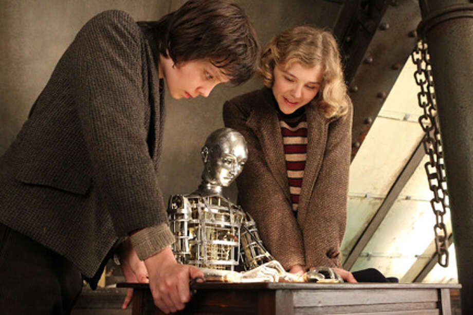 """Asa Butterfield as Hugo Cabret and Chloe Grace Moretz as Isabelle in """"Hugo."""""""