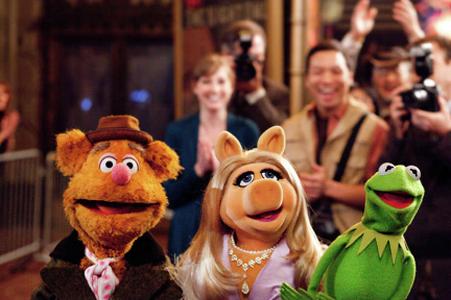 """(L-R) Fozzie Bear, Miss Piggy and Kermit the Frog in """"The Muppets."""" Photo: Scott Garfield / ©Disney Enterprises, Inc. All Rights Reserved."""