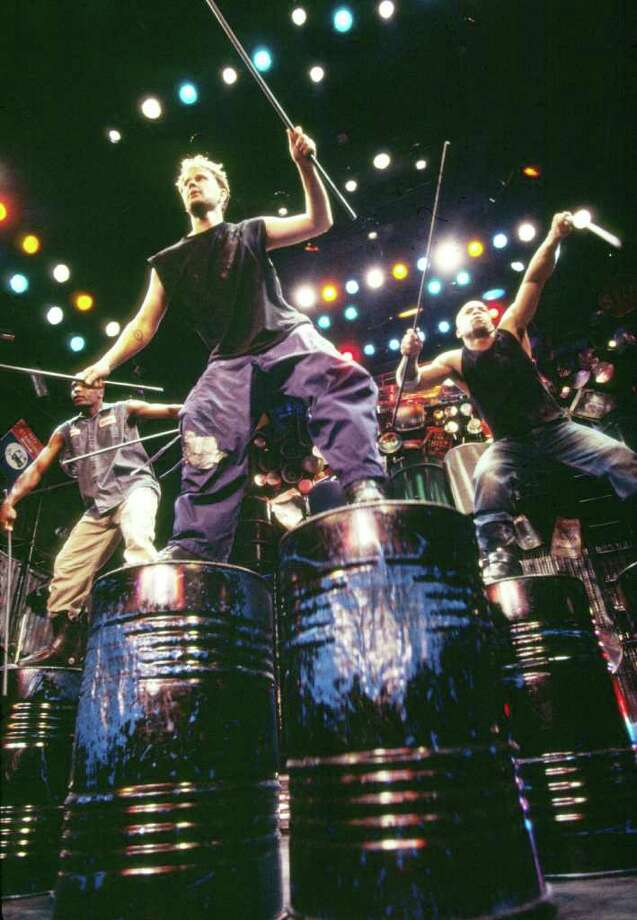 "Members of the ""Stomp"" percussion troupe pound awayay on oil drums. The show comes to the Majestic Theatre Nov. 4-6, 2011. Photo: Courtesy Junichi Takahashi"