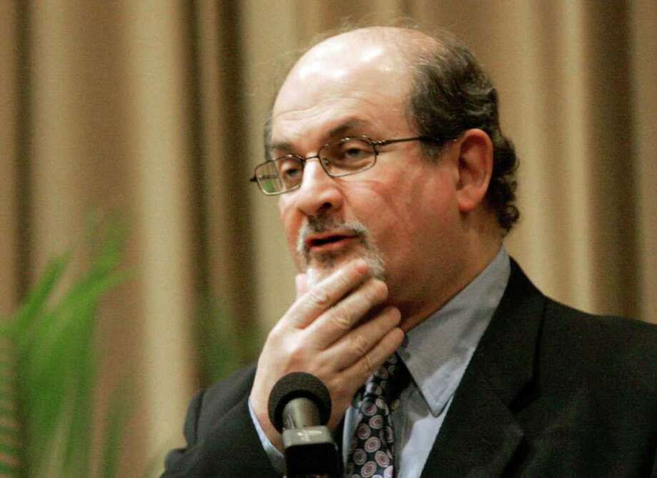 ** FILE ** In this April 9, 2008 file photo, British author Salman Rushdie talks about his book at the University of South Carolina's student-community course, in Columbia, S.C.. Rushdie is threatening to sue a publisher over a book by a former bodyguard that he says portrays him as cheap, nasty and arrogant and depicts his police guards as drinking on duty, The Guardian newspaper reported Saturday, Aug. 2, 2008. Photo: Mary Ann Chastain, AP / AP