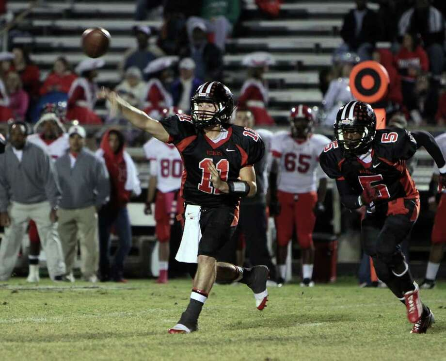 Cody Goins releases a pass during the victory over Diboll Photo: Charles Kerr