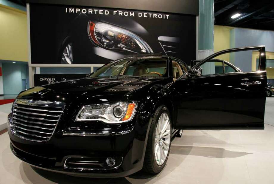 In this Oct. 28, 2011 photo, a 2012 Chrysler 300 is displayed at the 41st annual South Florida International Auto Show, in Miami Beach, Fla. Chrysler said Tuesday, Nov. 1, 2011, its U.S. sales jumped 27 percent in October because of strong demand for its Jeep and Chrysler brand vehicles. It was the company's best October sales since 2007.(AP Photo/Lynne Sladky) Photo: Lynne Sladky / AP