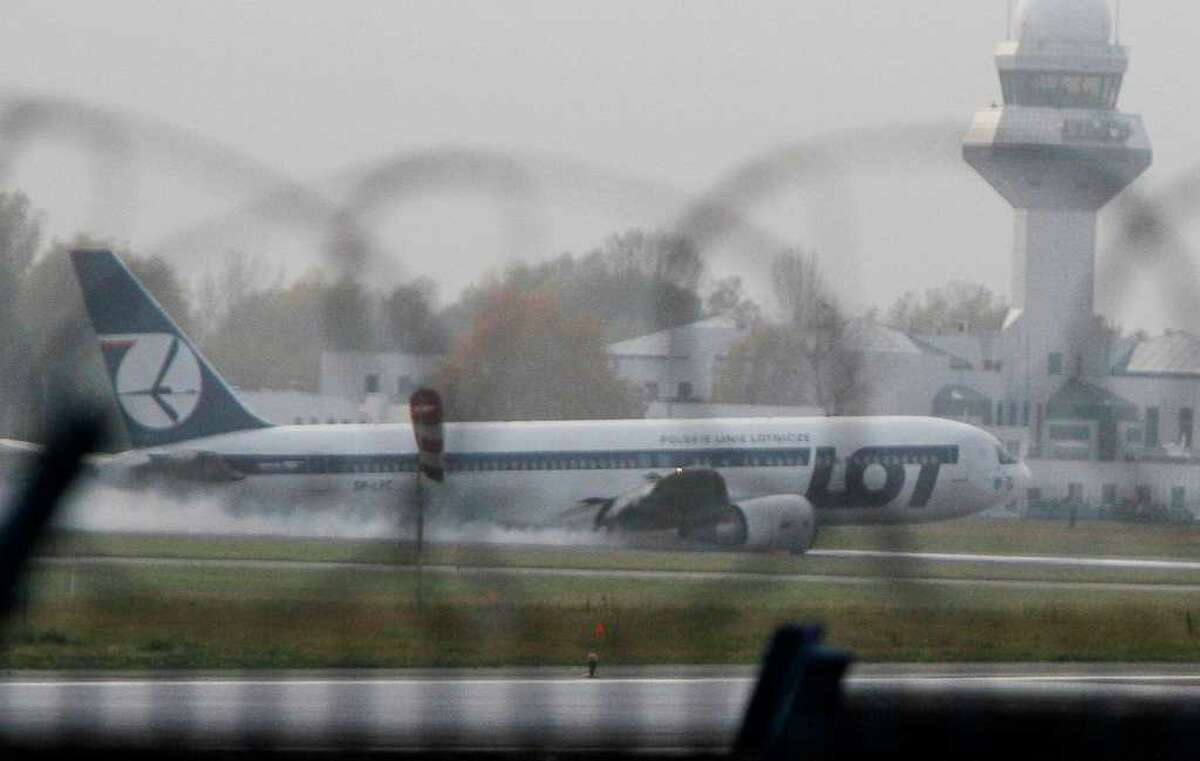 A Boeing 767 of Polish LOT airlines makes an emergency landing at Warsaw airport, Poland,Tuesday, Nov. 1, 2011. The plane was en route from Newark with 230 people on board but no one was injured.