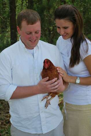 He always felt a little cocky when he held his hen. Photo: Courtesy AwkwardFamilyPhotos.com