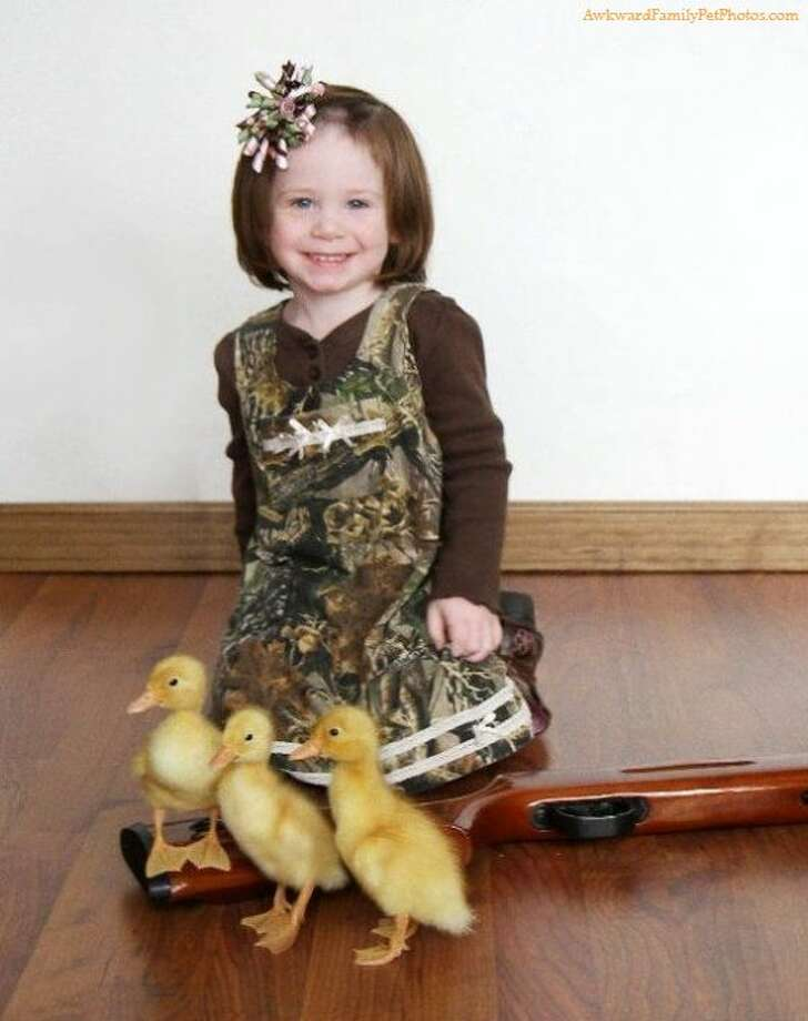 Who knew a gun could be so adorable? Photo: Courtesy AwkwardFamilyPhotos.com