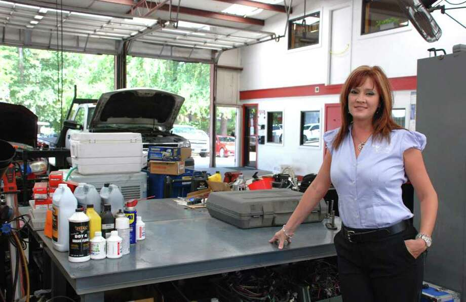 LINDSAY PEYTON: FOR THE CHRONICLE IN THE SHOP: Amy Milstead, president of Milstead Automotive, started working her way up in the family business at a young age. Photo: Lindsay Peyton