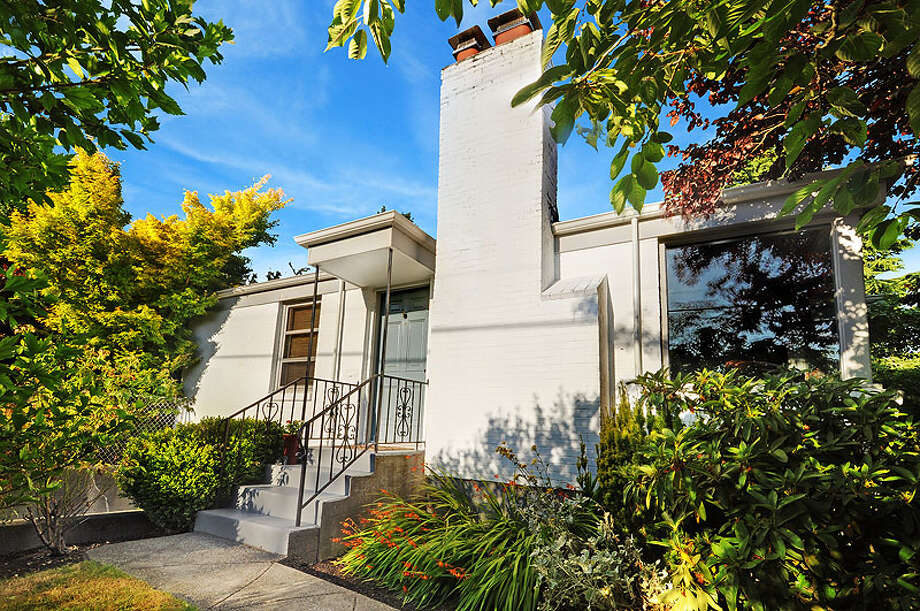 Sunset Hill is a popular neighborhood convenient to Puget Sound, hip Ballard and downtown Seattle. Here are three nice 1940s homes there for less than $500,000, starting with this one at 7002 28th Ave. N.W. The 1,800-square-foot house, built in 1946, has three bedrooms, including a basement room with a fireplace, 1.5 bathrooms, a gas fireplace in the living room, tiled kitchen and bath and back porch on the 3,172-square-foot lot. It's listed for $475,000. Photo: John L. Scott Real Estate
