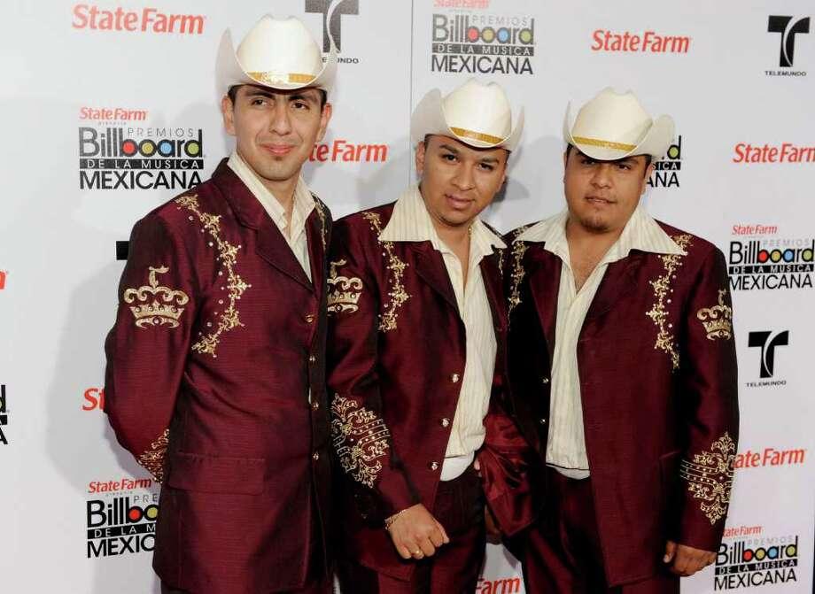 """El Trono De México, Feb. 19, 7 p.m.Regional Mexican band topped Billboard's Latin albums chart with its 2010 CD """"Quiero Decirte Que Te Amo."""" Last year's """"Sigo Estando Contigo,"""" which included the singles """"La Ciudad del Olvido"""" and """"No la Voy a Engañar,"""" also was a hit. CHRIS PIZZELLO / ASSOCIATED PRESS Photo: AP"""