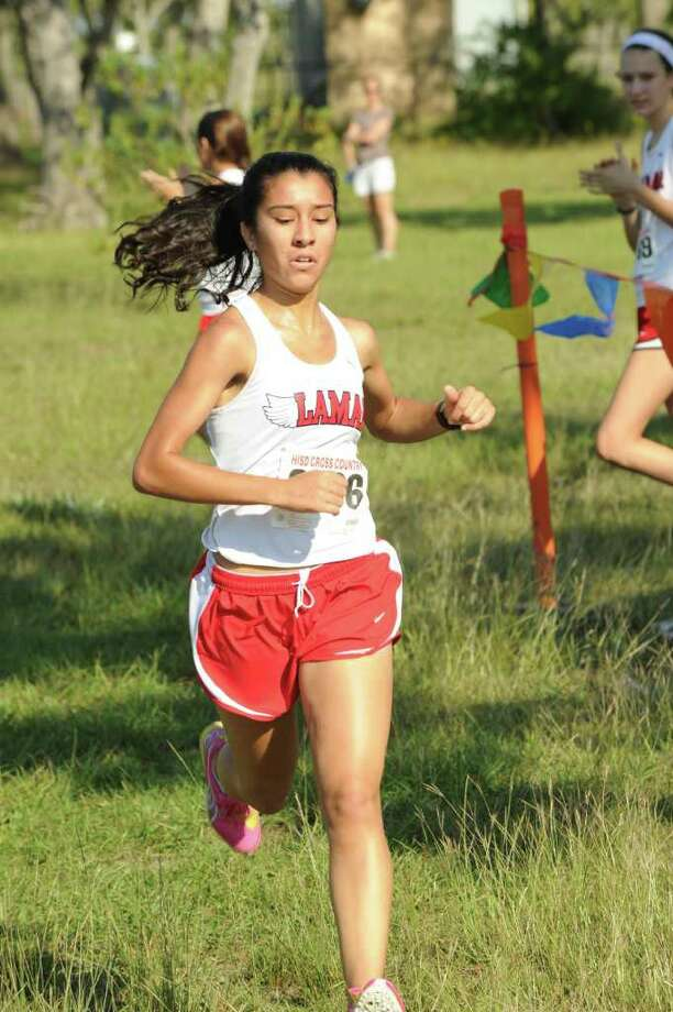 EDDY MATCHETTE: FOR THE CHRONICLE WINNING FORM: Lamar's Gabriella Busquet crosses the finish line first to win the District 20-5A girls cross country race last week. The Redskins now will race for state berths at this weekend's Region III meet at Atascocita. Photo: Eddy Matchette / freelance