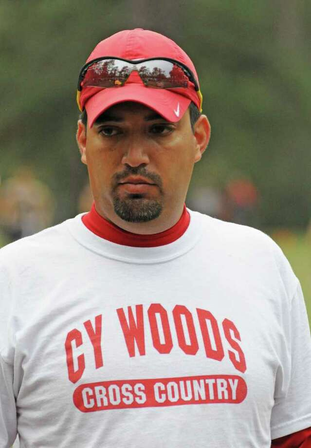Cy Woods coach Gregory Zarate saw his boys team take top honors and the Lady Wildcats place third at the District 17-5A Cross Country Meet on Oct. 28, 2011 at Spring Creek Park in Tomball. Photo: L. Scott Hainline / For The Chronicle