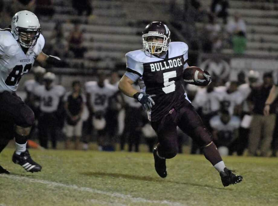 Reagan fullback Dylan Wilburn (#5) scrambles with Northbrook's Jose Arroyo (#82) on his heels during their game at Dyer Stadium Thursday 9/15/11. Photo by Tony Bullard. Photo: Tony Bullard / Credit: for the Chronicle