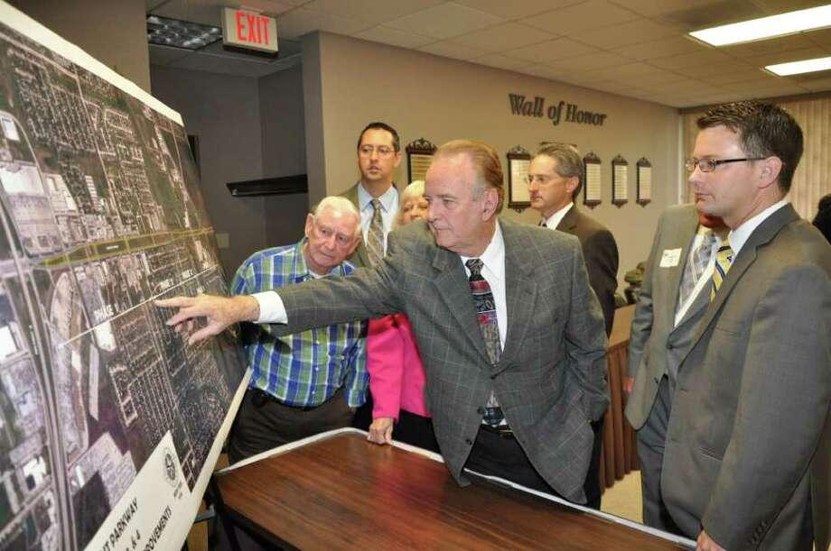 COURTESY RICHARD SCOTT PROJECT DETAILS: Harris County Precinct 2 Commissioner Jack Morman, center, discusses the $12 million Fairmont Parkway improvement project. Photo: CITY OF PASADENA