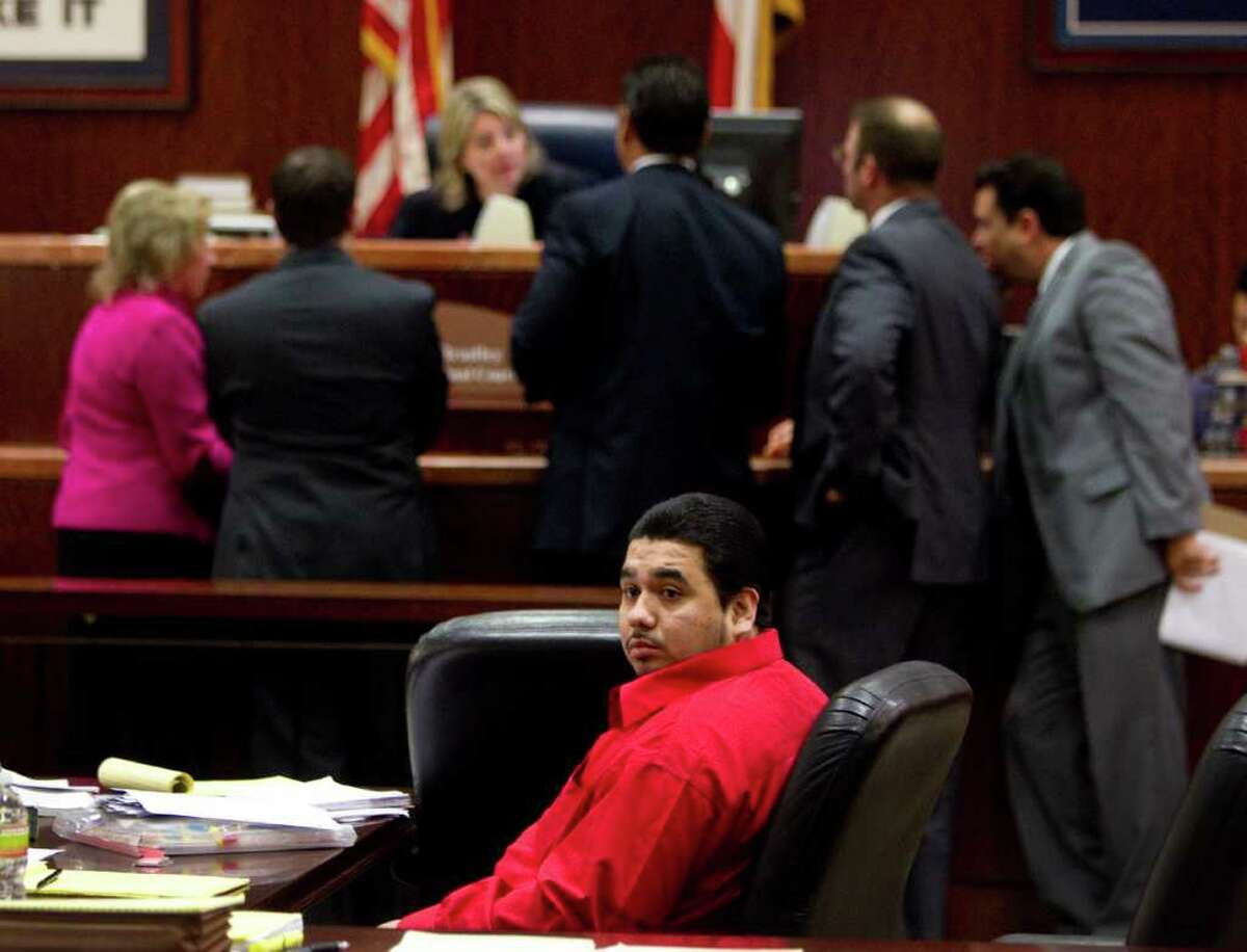 Damian Ricardo Flores sits at the defense table during his capital attempted murder trial Tuesday, Nov. 1, 2011, in Houston. Flores is accused of shooting the wife of a Houston lawyer in what investigators say was the third attempt on her life, in a murder-for-hire plot. ( Brett Coomer / Houston Chronicle )