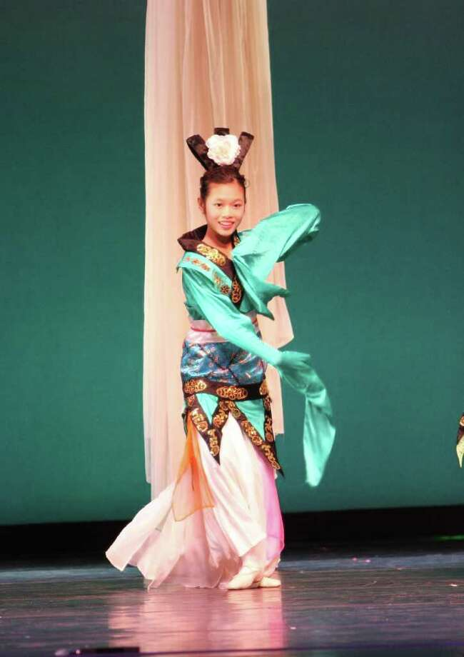 COURTESY CHAN FAMILY GRACE PERSONIFIED: Emily Chan, 14, is a member of the nonprofit troupe associated with the studio, Dance of Asian America. Chan is one of approximately 35 members in Dance of Asian America, which admits dancers by open audition annually. Photo: COURTESY CHAN FAMILY