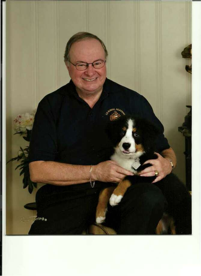 PROTECTING THE PAST: Hunters Creek resident John Kendall, pictured with his 17-week-old Bernese mountain puppy, Dearie, is executive director of the Houston Maritime Museum, 2204 Dorrington St., Houston. Photo: BUZ MARVINS