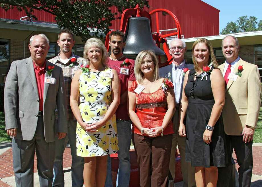 HONOREES: Hall of Honor inductees pose for pictures after a luncheon in their honor at the school on Oct. 14. From left, Al Carter; relatives of Mike Kocyon (son Cody, wife Cynthia, son Jake); Cindy Burke, widow of Grady Don Burke; Dan McIlhany; Kyla Holas; and Glenn Lutz. Photo: COURTESY PASADENA ISD