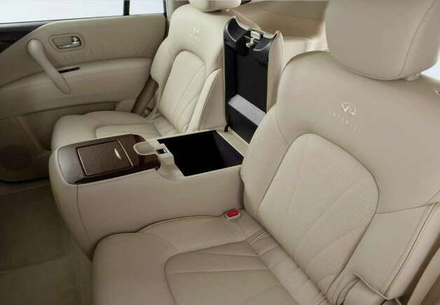 Captain's chairs in the middle row include a center console with storage and cup holders in the QX56. Either seat easily folds forward for entry to the third-row seat. COURTESY OF NISSAN NORTH AMERICA INC. Photo: Nissan North America, COURTESY OF NISSAN NORTH AMERICA INC.