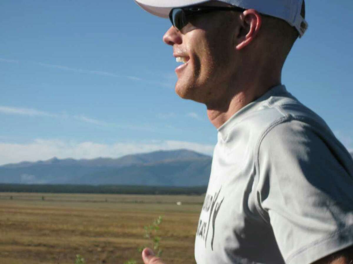 David Brown smiles on one of the few flat smooth sections of the 2011 100-mile-long Leadville 100 trail run in Leadville Colorado. Photo by Colin McDonald