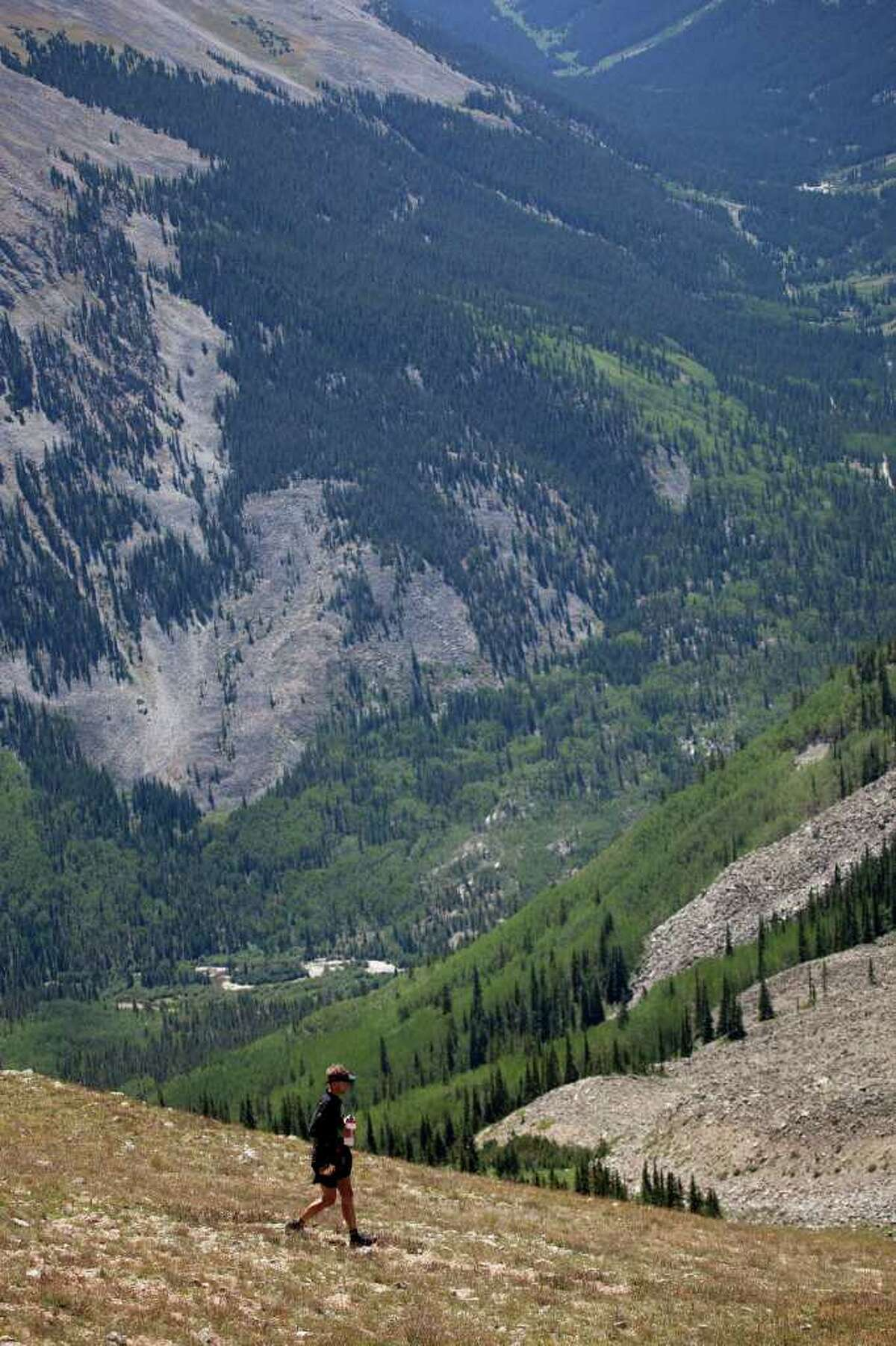 A race heads down from the crest of the 12,600 foot Hope pass on the second half of the 2011 Leadville 100 trail run. Photo courtesy of Glen Delman Photography.