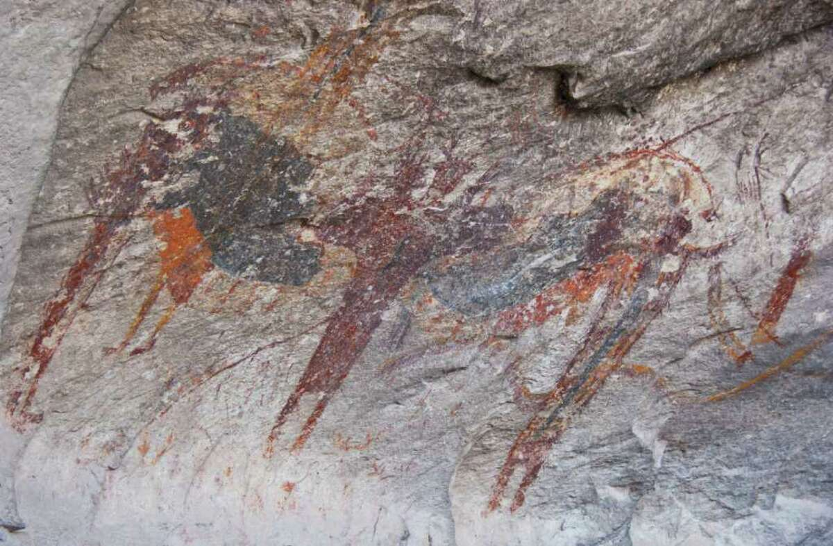 Rock art between 3,000 and 4,000 years old covers the walls of a cavern in Seminole Canyon State Park.